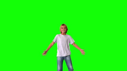 Boy jumping up and down on green screen