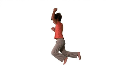 Side view of boy jumping on white background