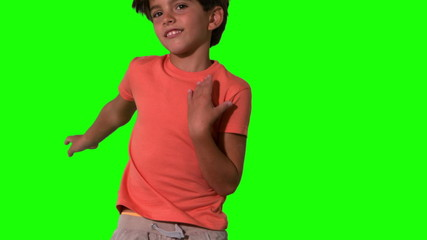 Close up of boy jumping on green screen