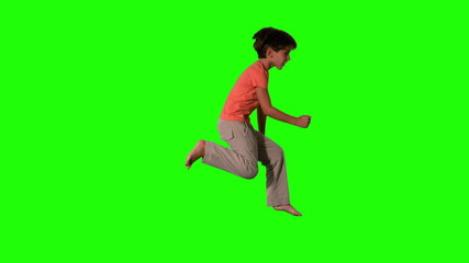 Boy jumping on green screen side view