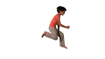 Boy jumping on white background side view