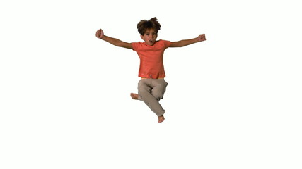 Boy jumping and cheering on white background