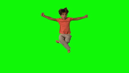 Boy jumping and cheering on green screen