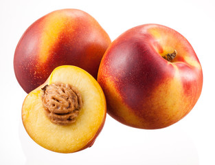 Nectarines with half isolated on white background