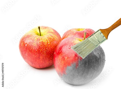 paintbrush painting a fresh red wet apple