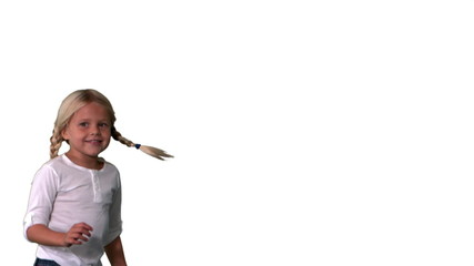 Cute girl in pigtails jumping on white background
