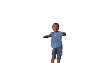 Boy in denim shorts jumping on white background
