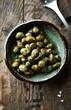 Pickled capers in a small dish