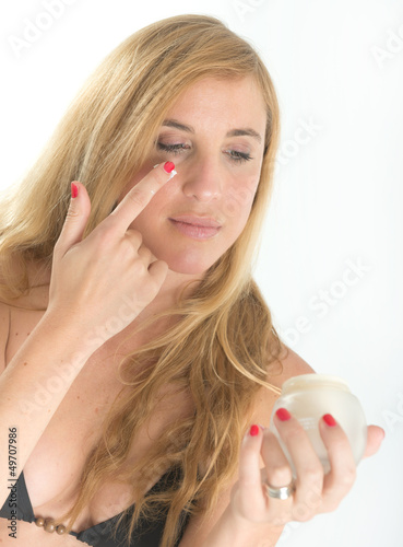 Girl applying sun block