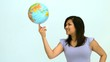 Smiling woman spinning globe on finger