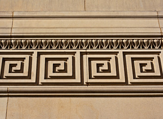 Intricate mouldings on old sandstone building