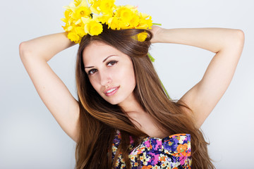 young beautiful teen girl with daffodils