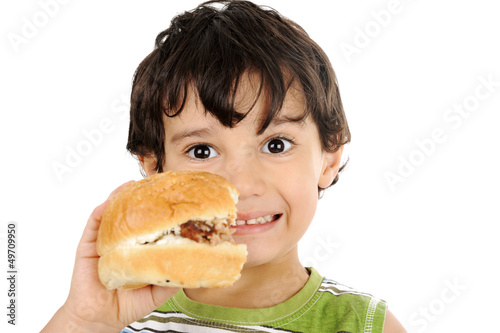 Happy child holding hamburger isolated