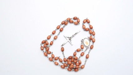 Rosary beads on white surface