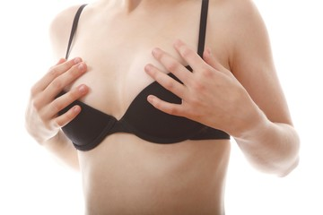 young female body with black bra (white background)