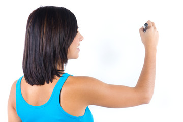 Attractive woman typing on a white wall