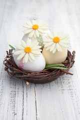 Easter eggs and flowers in a nest