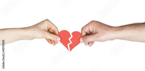 Man and woman hands holding broken heart