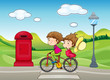 A boy and a girl biking
