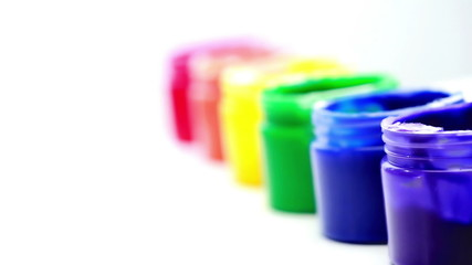 Rainbow paint pots in a line for gay pride