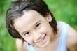 Closeup portrait of a little kid in nature