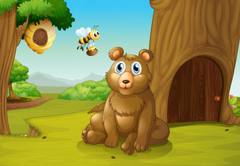 A bear and a bee near a treehouse