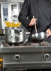 Male Chef Preparing Spaghetti