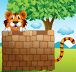 A  tiger hiding on a pile of bricks