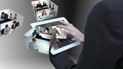 Businesswoman using tablet to view montage of business people