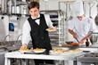 Waiter And Chef Working In Commercial Kitchen - 49712751