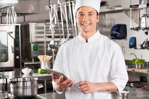 Happy Chef Holding Tablet Computer