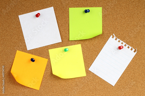 Colour note papers on wooden background.