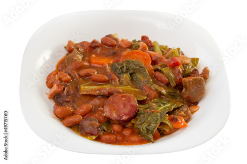 sausages with carrot, beans and cabbage on the plate