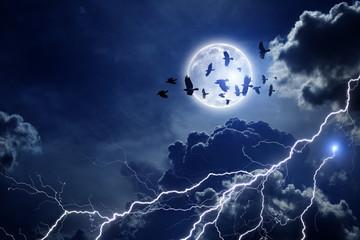 Stormy sky, flock of ravens