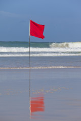 Red Safety Flag on a Beach