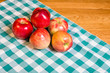 Fresh red apples on checked cloth