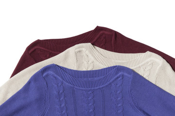 Fragment of three sweaters