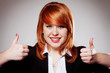 smiling businesswoman with thumbs up gesture
