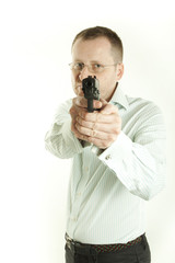 Young man is pointing pistol on white background
