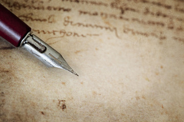 Vintage Nib Pen over Grunge Text