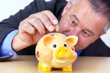 Man's money in his piggy bank