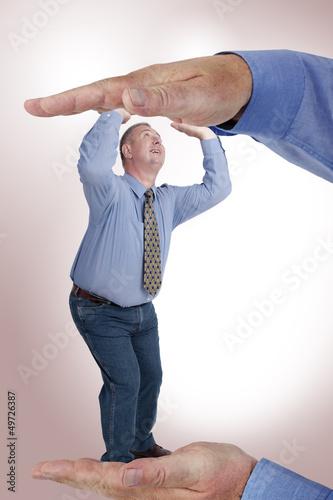 Man is under pressure between two hands