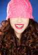 Attractive woman wearing pink hat