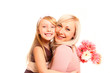 Happy mother and daughter hugging with flowers isolated on white