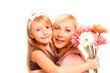 Daughter giving her mother flowers and hugging isolated on white