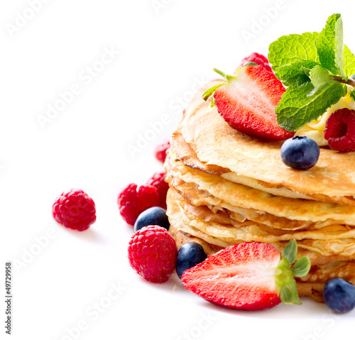 Pancake. Crepes With Berries. Pancakes stack isolated on a White