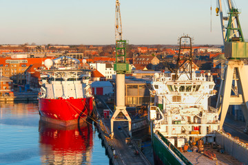 Cargo port and red ship