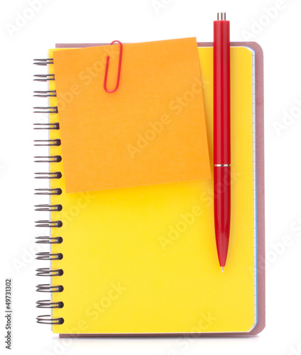 Yellow cover notebook with notice paper and pen