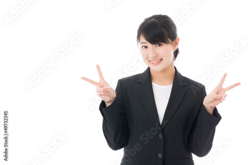 a young businesswoman showing v sign