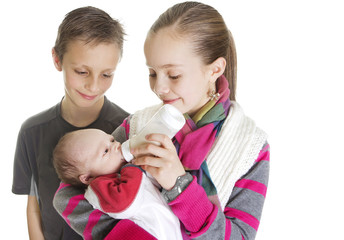 Siblings Caring for their new Baby Brother